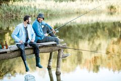 Free Two Men Fishing On The Lake Stock Images - 121184964