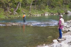Two Men Fishing for Rainbow Trout. At Roaring River State Park near Cassville, Missouri Royalty Free Stock Photos