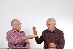 Two men with fruits royalty free stock photography