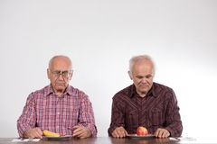 Two men with fruits stock image