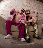 Two men in funky clothes Royalty Free Stock Image