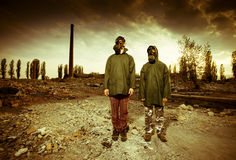 Two men in gas masks Stock Image