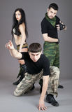 Two men and girl in military uniform Stock Photography