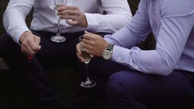 Two men with glasses of champagne. Outdoors stock video footage