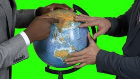 Two men with a globe. Businessmen on green background. Blurring the borders. Masters of the world stock footage