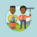 Two men are going to plant flower. Royalty Free Stock Photography