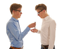 Two men handing over keys Stock Images