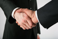 Two men handshake Stock Images