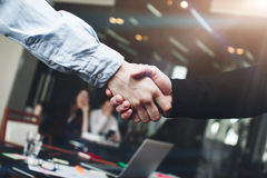 Two men handshakes after important business conference in modern. Loft room stock images