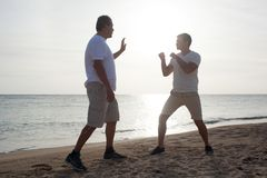 Two men having boxing training on the beach Royalty Free Stock Image