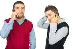 Two men having conversation by phones Royalty Free Stock Photos