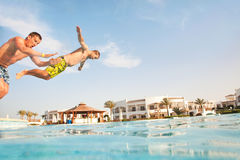 Two men having fun at swimming pool. Royalty Free Stock Photo
