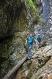 Two men hiker walking in a canyon Royalty Free Stock Photography