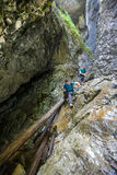 Two men hiker walking in a canyon Royalty Free Stock Photo