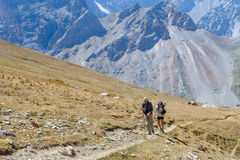 Two men hiking in Himalaya mountains Stock Photo