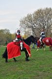 Two men in historical costumes ride horses Stock Photography