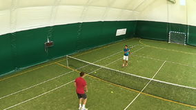 Two men hit the ball at the same time on the tennis court stock video footage