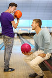 Two men hold balls in bowling club Royalty Free Stock Photo