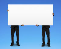Two men holding blank board Stock Photos