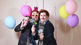 Two men holding boards in love in photo booth stock video footage