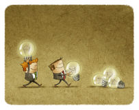 Two men holding lighted bulbs Stock Photography