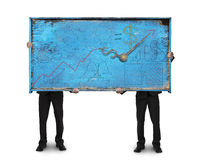 Two men holding old blue doodles billboard isolated on white Stock Image