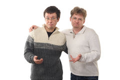 Two men holding out  hands. With expression of disappointment on faces, isolated on white background Stock Images