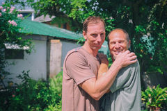 Two men hugging playfully Stock Image