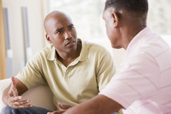 Free Two Men In Living Room Talking Royalty Free Stock Photography - 5468357