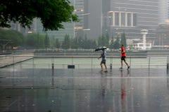 Men jogging under the rain in Singapore stock photo