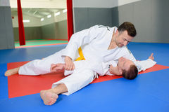 Two men on judo mat. Two men on a judo mat Royalty Free Stock Image