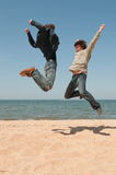 Two men in a jump. Stock Images