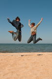Two men in a jump. Stock Image