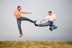 Two men kicking Royalty Free Stock Photography