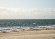 Two men kitesurfing on the beach in Indian ocean in Perth. Western Australia Royalty Free Stock Photography