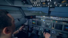 Two men are landing an aircraft in a flight simulation