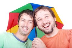 Two men laughing. Two funny men are laughing under umbrella Stock Images