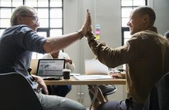 Two Men Leaning in Table royalty free stock photo