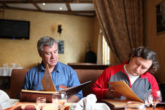 Two men look menu Royalty Free Stock Photography