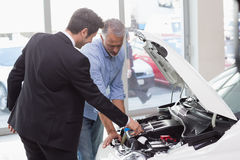 Two men looking at a car engine Stock Photo