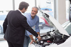 Two men looking at a car engine Royalty Free Stock Photo
