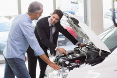 Two men looking at a car engine Royalty Free Stock Image
