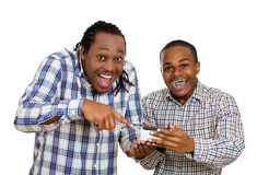 Two men looking excited, watching football game on smartphone Stock Photos