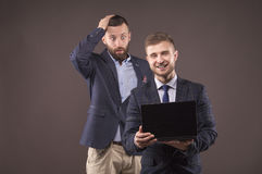 Two men looking at laptop Stock Image