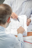 Two men looking at plans inside Royalty Free Stock Photos