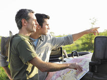 Two Men With Map Outdoors Stock Image