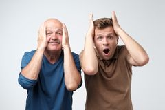 Two men mature father and son excited shocking. stock images