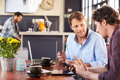 Two men meeting at a coffee shop Stock Photos