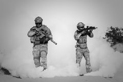 Two Men in Military Clothing With Guns Stock Photos
