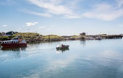 Two men in a motor boat sailing along the bay. Sea fishing. Norw stock images